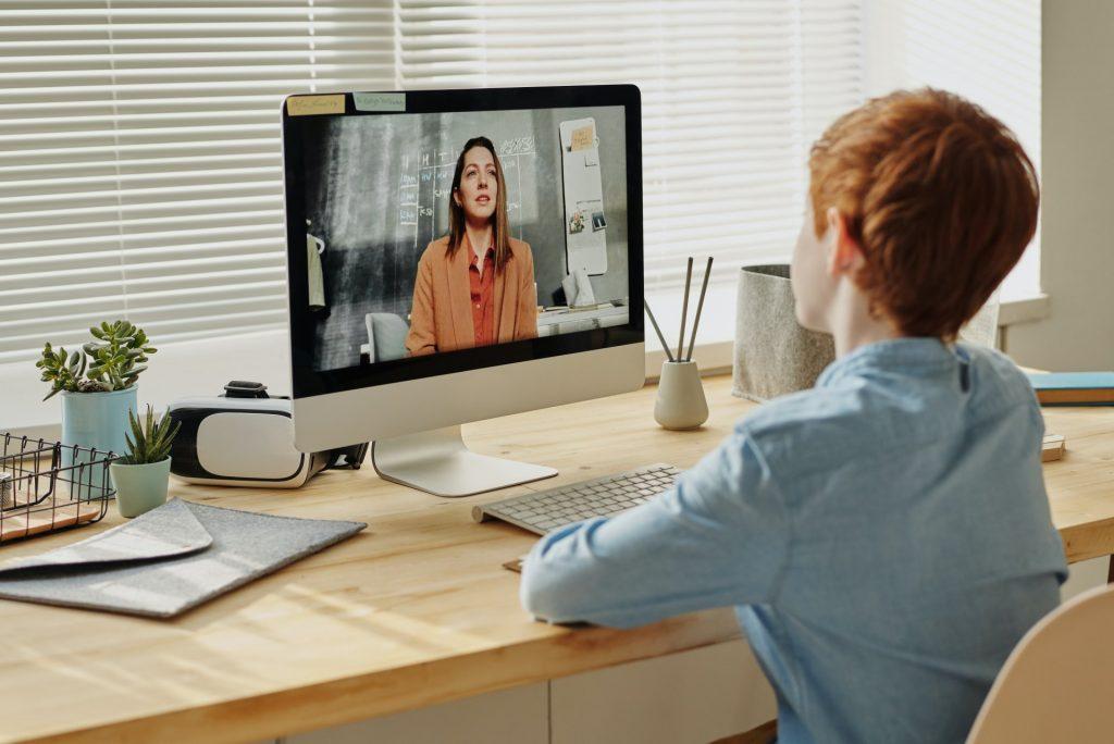 Child attending video call with a teacher